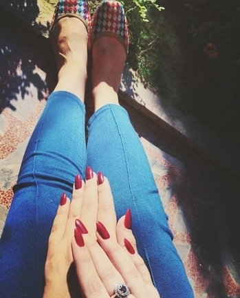 love the bright hot red color on her nails💅 and a pretty jeans👖 #fashionstatement