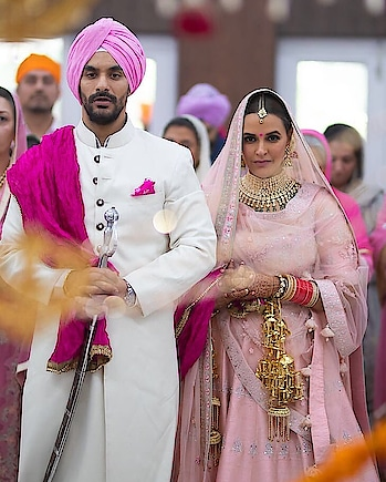 Another bride in the town! Actress@nehadhupiatied the knot with Actor@angadbediat an intimate ceremony with family and closest friends!  #nehadhupia #angadbedi#nehadhupiawedding#nehadhupiaangadbedi#bollywood#bollywoodweddins#celebweddings#celebritybride#bollywoodactress#nehadhupiafans#anandkaraj#celebwedding#indianbride#bollywoodshaadi#weddingsutra#pinklehenga#lehenga#punjabiwedding #bollywoodactor #bollywoodlovers #bollywoodnews