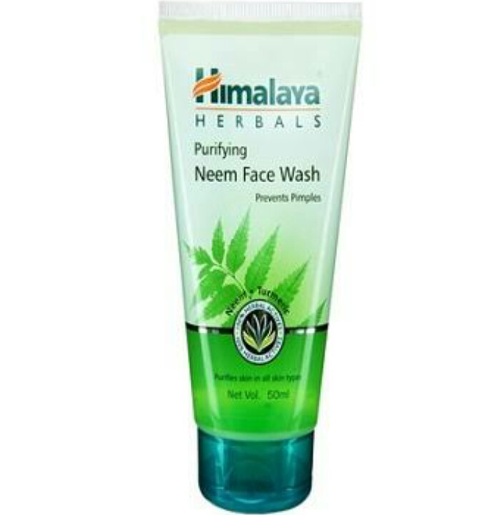 Himalaya Neem Face Wash   Himalaya Neem Face wash claims: A soap-free herbal formulation that gently removes impurities and prevents pimples. Neem kills problem-causing bacteria and Turmeric effectively controls acne and pimples.  Usage: Moisten face and neck. Apply Purifying Face Wash and gently work up a lather using a circular motion. Wash off and pat dry.  himalaya neem face wash back Ingredients: Each gm contains extracts of  Nimba leaf- 50 gm  Haridra- 5 gm  Inactives- Phenoxyethanol, Methylchloroisothiazolinone, Methylisothiazolinone.  Price: 130 INR for 150 ml ( sample size– 15 INR for 15 ml ).  Shell life: 3 years.   Packaging: The face wash comes in a transparent tube with a green screw fit cap. The packaging is fit for travelling. There is absolutely no spilling of the product and the plastic is sturdy too. So it is a decent yet simple packaging.    My take on Himalaya Neem Face wash: The Himalaya Neem face wash is in a green colour gel form which lathers well which makes it easy to apply on face and neck. The consistency is not thick, more on the medium side. This Himalaya neem face wash is extremely soft to touch with no coarseness or scrubbing particles. The smell though is pleasing and I love the smell very much.  I apply the face wash twice daily and specially on days when I have pimples. It doesn't work like a miracle still with regular 2-3 days usage it dries the monsters up and my skin is relieved. But if I use this face wash in winter I feel my skin becomes dry and stretchy. So I wont suggest it for winters even if you have Oily skin. It is definitely not a choice for dry skinned beauties.  Just like the Himalaya Purifying Neem Face pack, it doesn't stain even a bit so I really doubt the presence of turmeric. Other than that I really don't have any kind of problem in this one. This face wash by Himalaya doesn't make high claims but does what it aims to do.    Pros:  1. Reduces pimples with regular use  2. Has neem and turmeric and so safe  3. Is 