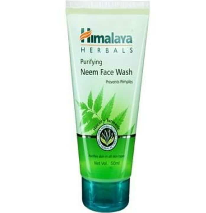 Himalaya Neem Face Wash   Himalaya Neem Face wash claims: A soap-free herbal formulation that gently removes impurities and prevents pimples. Neem kills problem-causing bacteria and Turmeric effectively controls acne and pimples.  Usage: Moisten face and neck. Apply Purifying Face Wash and gently work up a lather using a circular motion. Wash off and pat dry.  himalaya neem face wash back Ingredients: Each gm contains extracts of  Nimba leaf- 50 gm  Haridra- 5 gm  Inactives- Phenoxyethanol, Methylchloroisothiazolinone, Methylisothiazolinone.  Price: 130 INR for 150 ml ( sample size– 15 INR for 15 ml ).  Shell life: 3 years.   Packaging: The face wash comes in a transparent tube with a green screw fit cap. The packaging is fit for travelling. There is absolutely no spilling of the product and the plastic is sturdy too. So it is a decent yet simple packaging.    My take on Himalaya Neem Face wash: The Himalaya Neem face wash is in a green colour gel form which lathers well which makes it easy to apply on face and neck. The consistency is not thick, more on the medium side. This Himalaya neem face wash is extremely soft to touch with no coarseness or scrubbing particles. The smell though is pleasing and I love the smell very much.  I apply the face wash twice daily and specially on days when I have pimples. It doesn't work like a miracle still with regular 2-3 days usage it dries the monsters up and my skin is relieved. But if I use this face wash in winter I feel my skin becomes dry and stretchy. So I wont suggest it for winters even if you have Oily skin. It is definitely not a choice for dry skinned beauties.  Just like the Himalaya Purifying Neem Face pack, it doesn't stain even a bit so I really doubt the presence of turmeric. Other than that I really don't have any kind of problem in this one. This face wash by Himalaya doesn't make high claims but does what it aims to do.    Pros:  1. Reduces pimples with regular use  2. Has neem and turmeric and so safe  3. Is hypoallergenic.  4. Affordable  5. Easily available  6. Does what it claims to do  7. Sturdy and travel friendly packaging  Cons: 1. Doesn't give any yellow stain to the skin so I doubt the presence of turmeric.  2. Has preservatives  3. Not for dry skin people  4. Makes my oily-normal skin dry in winters  Recommendation and repurchase: I will recommend everyone who has acne to try out this Himalaya neem face wash. It will surely cure your problem. Dry skin people will have to skip it though.  I will repurchase it as I really need it whenever I have pimples. Otherwise I don't use it as such.  Overall:    The Himalaya Neem Face wash is best suited for oily-normal skin to get rid of pimples and rashes. A highly suggested product for all its natural goodness and effectiveness. A good creation by Himalaya Herbals.  #reviewoftheday #himalayaherbals #facewashreview #reviewblogger #soroposoblogger  #skincare