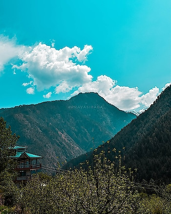 #mountains, #clouds and the #blue  #house at #kasol  #himachalpradesh