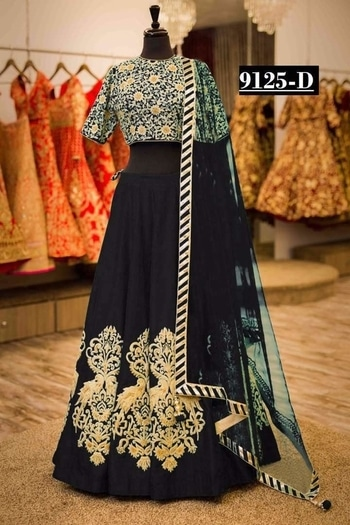 """Beautiful lehanga -@2750/- INR Only, Fabric details --  Midnight blue tapeta lengha with zari embroidery highlighted with  net dupatta, with a machine embroidered blouse. ****  Code: 9125"""""""""""""""" Title: blue machine embroidery lehenga choli with, embroidery blouse*** Size: Free ** Color: Blue, mehroon , black , green ** Fabric: tapeta ** Type: Embroidered ** Occasion: Festive, Wedding,  Ceremony, Party *** Neck Type: Round Neck ** Sleeve Type: Short Sleeve **  **WHATSAPP ME AT +91 9760614947**"""