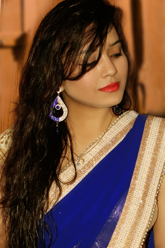 I am wearing a very simple yet very classic and elegant saree..A Blue Plain Saree with Heavy Golden Border stone & pearl work and A Heavy golden Blouse!  I don't know what's there between me and saree..I just really love it and it makes me look so real and classy!  To highlight the golden Touch and Royalness of the saree;I wanted to keep the look simple so I wored a heavy earring which is embezzled withblue stone studs some golden blue bangles on one hand and a bracelet on another. Luckily, the finger ring i wear all the time matched itself up with my outfit.  I kept my hair open with all its crimps and curls. Also follow me on instagram- @jyocrazee #jyocrazee #bloggerlife #bloggerawards #bloggerdiaries #fashion #saree #photoshootdiaries