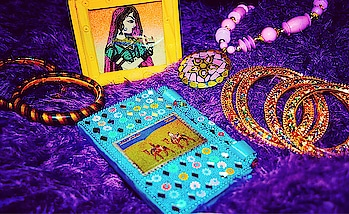 """So as promised, here are the souvenirs by grandma got from Rajasthan.  In the picture- Kundan Bangles, """"Lakh ki chuddiyan"""", a revolving pen stand with pictures of local art on all 4 sides, a necklace with earrings (not visible in the picture) and a bejeweled  diary with a pen.  Aren't grandparents the sweetest? . . . #chandigarhfashionblogger #delhifashionblogger  #bangalorefashionblogger  #mumbaifashionblogger  #fashionbloggerindia  #fashionblogger  #indianfashionblogger  #indianbloggernetwork  #blogger  #photography  #bangles  #fff  #likesforlikesback  #likeforlike   #bloggersofig  #fashionphotography #fashion  #mdblogs   #eyemakeup  #makeupblogger  #rajasthanijewellery  #beautyblogger  #gift  #love  #rajasthan  #stationary  #accessorieslove  #diaries"""