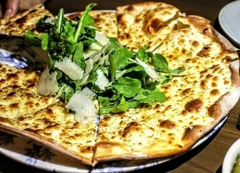 What do I say about this  outstanding flatbread they call it I would call it a paper thin pizza with truffle oil rocket leaves and parmesan just perfectly done.  . . #chef #cook #cooking #food #foodstagram #foodlover #instafood #instadaily #instalook #hungry #italian #indian #mexican #zomation #foodtalkindia #bombayfoodglogger #foodblogger #like4like #foodie #wearmumbai #foodgasm #eeeeeats #hungry #yummy #follow4follow #picoftheday #foodporn #foodphotography #jj #thai #foodtalkindia