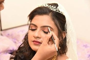 Sharons Glamorous Reception Look. #christianbride  #bridalmakeup #receptionlook #indianbride #bride #chennaimua #glowingskin #wingedeyeliner #falselashes #HDmakeup #macmakeup #maccosmetics #lovemyjob #instamakeup #flawlessbase #chennaiwedding #chennaimakeupartist #mua #hairstylist #softcurls #bridalmakeupartist #anastasiabeverlyhillsglowkit #abhthatglow #contour #highlights #strobing #sachacosmetics #kryolan #nyxcosmetics #paletteaffaire