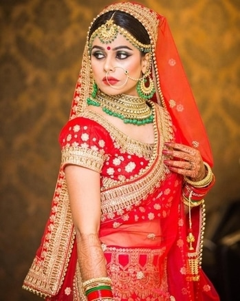 Dignified, regal brides like this give us bridal goals.  Buy such exotic lehengas & bridal jewellery from WedLista.com  Shot by: @rachitphotography  #WedLista #FashionForWeddings