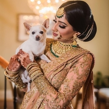 This majestic bride, dolled up in her mesmerising ensemble & sparkling jewellery posing with her best friend is just breathtaking.  Shop for wedding from WedLista.com for complete wedding fashion.  Shot by: @aaamovies  #WedLista #FashionForWeddings