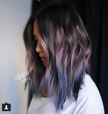 Geode Hair Is The Prettiest Trend You've Ever Seen! When it comes to hair colour, there are clearly no boundaries. From rose gold to rainbow, colorists have experimented with some surprising hues. However, the latest trend blows it all out of the water.  Dubbed as geode hair, this fad is inspired by the shimmery crystals that line the cavities of rocks. It involves using iridescent or metallic dyes in jewel tones. From deep purples and blues, to turquoise and green, the range of shades used are beyond pretty. Just like a geode however, this trend only has colour in some sections. If a subtle look is what you are after,dust your ends with these hues and leave your roots intact. For a bold surprise, hide a section of your dyed strands beneath your natural hair. If you are looking to try out this trend, consider your natural colour first. Those of you with lighter locks can straight up begin with the fun shades. Ifyour tresses are dark, you will need to add some bleach before dyeing your hair. This step ensures that the jewel tones stay bright and true. Personally, i am in love with the mesmerising hues and whimsical nature of this trend. Comment and let us know if you are going to try it out!