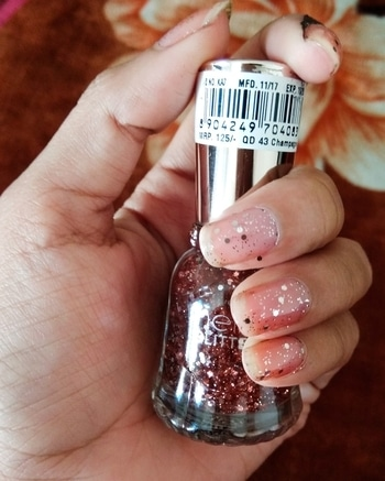 Hey guys, so I am going to share 7 beautiful glitter polishes and 4 shine polishes 💅from @nelf_cosmetics which are perfect for Christmas and new year party.  So stay tuned to my insta posts and turn on the notification of the same so that you don't miss any post. 💠This is swatch 6/11 and it is named as 43 Champagne .  This contains medium round and small small silver glitters with pink jelly base Polish and the application is also easy. The consistency of the polish is so perfect and it dries in around 1-2 minute. 💠Here I have applied two coats of it on my nails to build up the light pink color.  This looks very subtle and it can be perfect for the cocktail party look. It gives natural flush look to nails with glitter. 💠The price of this nail paint is 125 INR only which is quite affordable considering the quality. I would highly recommend this to everyone.👍👍. . . .  #beautyfitnessfunda #beautyblogger #nelfcosmetics #vadodarablogger #barodablogger #indianbeautyblogger #ahmedabadblogger #mumbaiblogger #productreview #honestreview #vadodara #fashionblogger #vadodarafashionblogger #nelfnailpaints #glitternails #glitternailpaints #glittermania #glitterworld #nailpaintaddict #notd #nailpaint #nailart