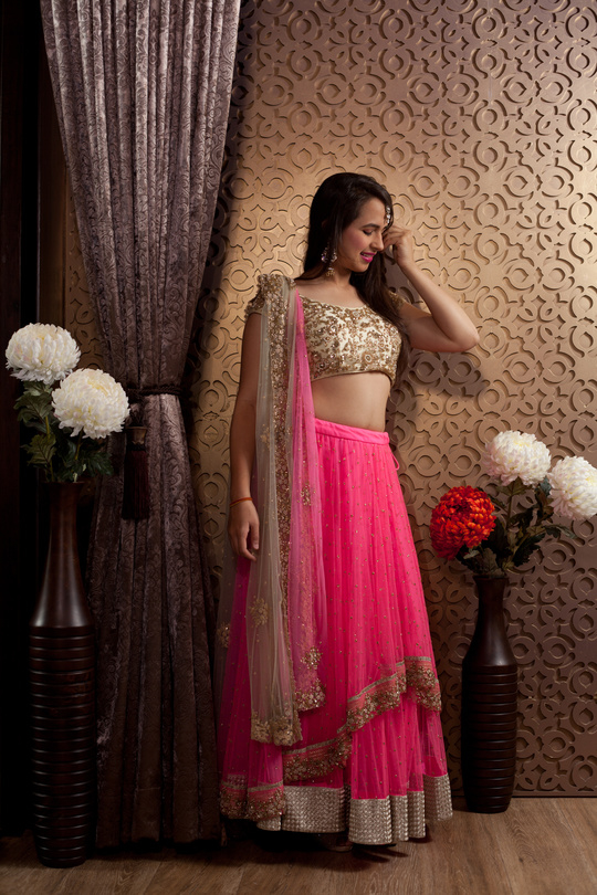 #prettyinpink  Friends of the bride look stylish and stand out in this indo-western neon pink lehenga.  Rent it at Rent An Attire #neonpinklove #lehenga #wedding #weddingwear #friendsofthebride #rentanattire #Differentisbeautiful  #lehengas