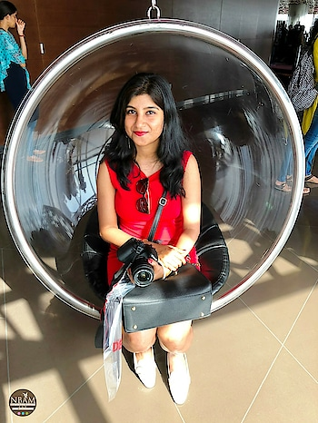 🙌 Raise your hand if you love swings 😍👐 The moment I found this beautiful corner inside #burjkhalifa  #skyscrapper, I knew I had to sit on that #hangingchair and keep swinging 😄 But guys, I literally had to manipulate a kid to get off it first😛😀Trust me, the view of #dubaicity from there was stunning! #atthetopburjkhalifa #observationdeck #dubai  #anamikachattopadhyaya . . .  Outfit deets ➡️ Bodycon RedDress👗- @shopperstop, India. Shoes 👡- @Zara, Hong Kong . Bag 👜 - Local Shop, Hong Kong Sunglasses 😎- @RalphLauren . . . . . . . . . . . .  #nbamtravels #middleeast  #uae  #naturalbeautyandmakeup  #nbamblog #roposoblogger  #roposophoto  #indiantravelblogger  #travelblogger  #travelinstyle #summervacation  #roposotravel  #lifestyleblogger  #styleblogger  #reddress #bodycondress  #summerstyle #summerfashion  #worldfamous  #travelbloggerlife #roposobeauty #swing