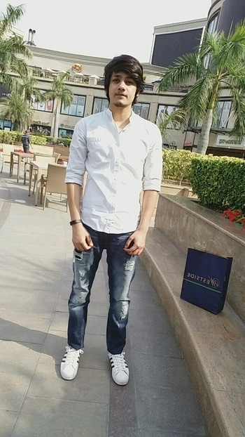 I am wearing white shirt with chinese collar  from Highlander and i have paired it with my ripped jeans from Moda Rapido and my Adidas superstar sneakers  for accessories i am wearing my fit band from Portronics ...this outfit is very comfortable for college days and this white and blue combination makes the outfit more interesting. #allaboutlocation  #roposomen #vasantkunj #highlander #adidas #modarapido #smartwatch