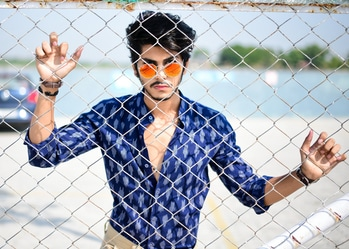 TO ACHIEVE THE IMPOSSIBLE, YOU NEED TO SEE THE INVISIBLE. 👀 ___________________________________  IKAT PRINT BLUE SHIRT BY - @theindianpeacock  ___________________________________  #thestyledweller #thestyledwellerXindianpeacock #blueshirt #ikatprint #allblue #rayban #uvprotectionglasses #photographyconcept #indianpeacock #shirt #maleblogger #indianblogger #suratblogger #ikatprintshirt #roposotalenthunt