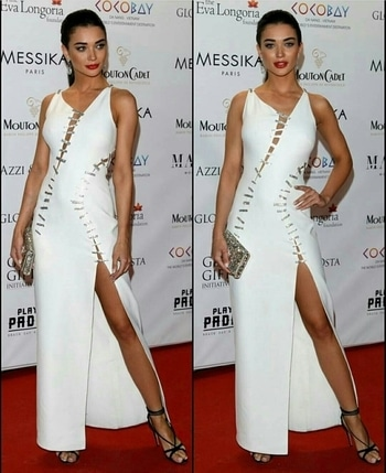 Amy Jackson looks Stunning in a White Thigh Slit Evening Gown for a Cannes 2017 event ....