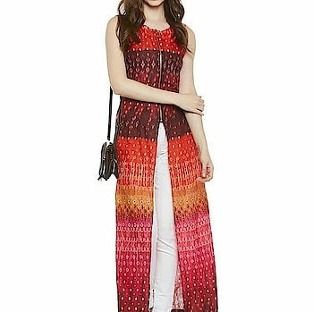 Multicolored slit maxi top with front zip to buy click the link in bio.
