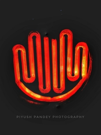 #instadiaries   #travelgram  #mobilephotography 📸📸  #glow  #of #heater  #light #on #the #coil #of #wire  #set  #round #on #the #base #of  #heater #in #the #dark #of #room  #it's  #glow_ #like #a #modern #way #to #warmup  #moto_g4_plus  #like4like  #followforfollow   #follow_for_peace💫