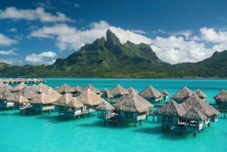 Bora Bora,  French Polynesia    Bora Bora is an island that once was a volcano, which has subsequently subsided and formed a barrier reef. The reef ecosystem allows for pristine clear blue water and reefs limit waves, providing a protected sanctuary. #travel