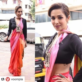 indiafashionblogger.com #Repost @voompla (@get_repost) ・・・ A cropped blazer and a saree 😲😍 Who would've thunk!! Malaika Arora Khan goes glamorously desi at a fashion collection launch in Mumbai today ❤️❤️ FOLLOW 👉 @voompla . Inquiries 👉 @ppbakshi . Lovely lookbook of @malaikaarorakhanofficial  You must be check this post👉http://indiafashionblogger.com/8-ways-slay-saree/ Follow @indiafashionblogger.com for daily dose of fashion and travel✨ #indiafashionblogger #ifbteam #shailygupta #kajalmishra #fashionblogger #travelblogger #voompla #malaikaarorakhan #bollywood #bollywoodstyle #bollywoodactress #bollywoodfashion #desilook #desistyle #desidiva #mumbaifashion #mumbaifashionblogger #mumbaifashionista #mumbaistreets #sareeblous #desivibes #indianvibes #indianjewelry #blazerswag #blazerdress #sareeswagr #sareetime