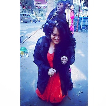 Orange dress looks bright with black jacket.....open hair....playing with a monkey....good time in short #orange #orangedress #black #blackjacket #openhair #monkey #playing #goodtimes #throwbackpic #moments #kolkata #kolkatafashionblogger