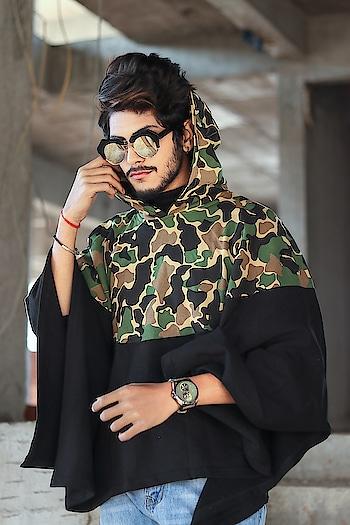 A trend of CAMO. . . Camouflage poncho by - @fugazeeinc . . Shot by - @callisto_studio . . #tsdfam #tsdstyle #thestyledweller  #poncho #camoflauge #black #mensfashioninfluencer  #menswear  #mensfashion  #mensponcho #streetstyle #menwithstreetstyle #fashion  #trend #blogger  #influencer  #suratblogger  #indianblogger  #indianinfluencer
