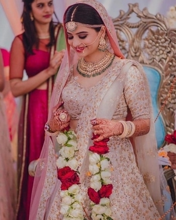 Look at this pretty pink bride, just mesmerizing!  Shop for such lovely lehengas with matching jewellery from WedLista.com  Pic Courtesy: @royalaffairweddings  #WedLista #FashionForWeddings