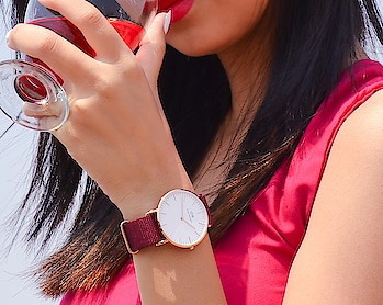 """Red dress, red lipstick & Roselyn on my wrist! I am all set for my night out with thenewest classic timepiece by DW. 🍷   Avail exclusive 15% discount with my code """"PTC15"""" to get yours now!  . . . . . . . . . . . . . . . #diksha #fromposetocloth  #DWnewclassics #danielwellington #DWnewlauch #DWIndia #DW #fashionblogger #indianblogger #ootdindian #sdmdaily#plixxoblogger #fashion#trending#red#watches#watch#newwatch"""