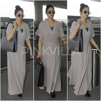 Airport Style : Sridevi in Bungalow 8. Sridevi was snapped at the Mumbai airport yesterday wearing a light grey linen maxi dress from Bungalow 8. Her dress was styled with black boots, a Goyard tote and round sunglasses.