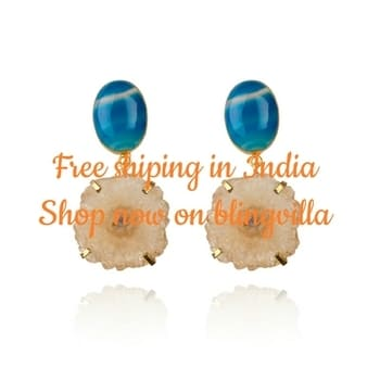 Razzle-dazzle with our attention grabbing Blue Ivy earrings. This pair oozes style and elegance making its wearer look like one in a million. Shop now on www.blingvilla.com Style speaks: Your ideal indo-western earring – suits well with dresses and Indian outfits alike. #jewelry #jewelryforwoman #blingvilla #stones #indian #contemporary #style #styles #fashion #shop #online #jewel #jewelryforsale #shopnow #insta #instagood #instadaily #picoftheday #instagood #instagram #khushboomishrastyling