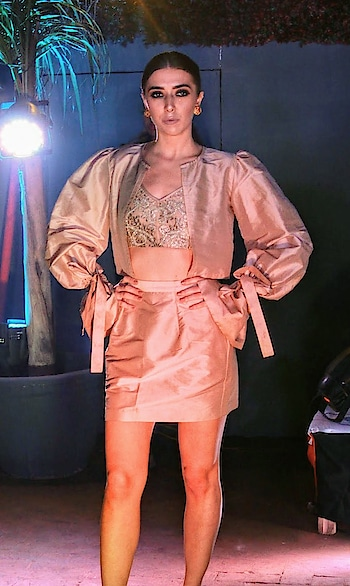 Broader, bigger, bulked up shoulders in our silk crop jacket teamed with embellished #mesh bralet... perfect to glam up those evenings in #meshbynityabajaj Grab this at #studionityabajaj @labelnityabajaj  #beige #silk #rosegold #metallic #nude #salmon #labelnityabajaj #NityaBajaj #bikergirl #bikerchic #mesh #autumnwinterfestive2018 #NityaBajaj #labelnityabajaj #meshbynityabajaj #powershoulder