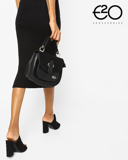 Black always carries grace along with it and it's a color that matches most of your outfits! #E2oFashion