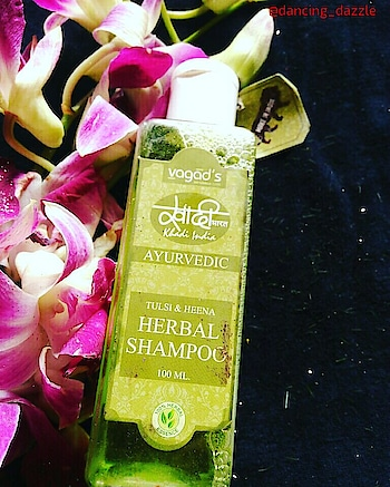 Vagad's Khadi Tulsi & Heena Herbal Shampoo review🍃  Hi beauties 😘  I am back with a review of my favorite vagad's Khadi product. It's the vagad's Khadi Henna & Tulsi herbal Shampoo. This is my Loved Product. Hope you will enjoy reading the review.   So guys let's jump into the review 👇                                                              About vagad's khadi:The Vagad's Khadi Personal Care Line consists of wide range of skincare, haircare and body-care Products. The products are Herbal/Ayurvedic and chemical free. Made from special blends of botanical extracts, nutrients and aromatic oils which are unique and highly effective, these products are SLS & Paraben free and totally Handmade. Vagad khadi offers widest range of Handmade Soaps, Shampoo, Hair & Body Oils, Body Lotions etc. These products are 100% natural and prepared from an Herbal formulation. It includes goodness of Neem, Tulsi, Rosewater, Aloevera, Almond and other natural herbs.   Ingredients:   1.Tulsi.  2.Heena Extract.  3.Aloe Vera Gel.   Price: 50ml(81 INR)/100ml(143 INR)/200ml(259ml)    ⏩Aherbal shampoo which deep cleanses your hair and scalp, Vagad's Khadi Tulsi & Heena Herbal Shampoo deep-conditions your hair and smoothes frizzy hair. It has natural herbal ingredients like Heena that add shine and strength to your hair along with Tulsi that cleanse the hair and keeps it dirt-free.  The Shampoo is enriched with natural herbal ingredients like Tulsi and Heena.Deep conditions your hair and smoothes frizzy hair.Adds shine and strength to your hair.   MY VIEW ON VAGAD'S KHADI HERBAL HENNA & TULSI SHAMPOO 🍃  Vagad's khadi Henna & Tulsi shampoo is free from SLS & parabens. It's affordable and easily available on Nykka. It's comes in a transparent plastic bottle with a white flip top cap. The packaging is travel-friendly. This shampoo contains Henna, Tulsi, Aloe vera.  The shampoo is not too much thick consistency. Very lovely green colour. It doesn't lather much, as this shampoo is completely herba