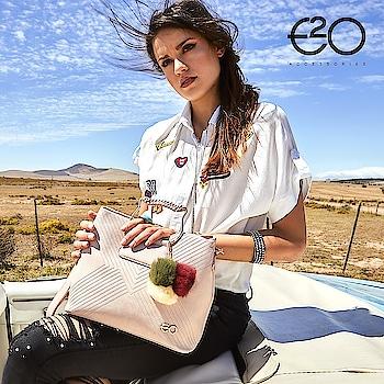 Add a dash of feminine touch to your handbag with pom pom embellishments! #E2oFashion
