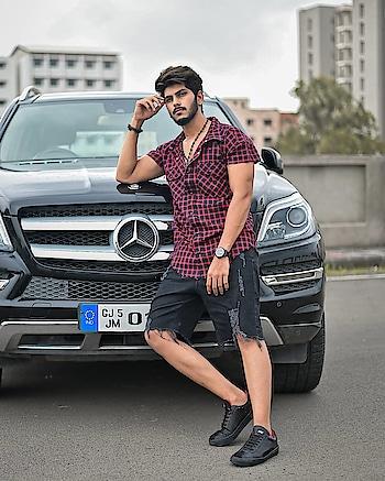 Kinda Road Trip Mood ! . . Shot by - @thedaydreamstudio . . #TSDFAM  #thestyledweller  #blackshorts #vacationmode #mensfashion  #fashioninfluencer  #fashionblogger  #fashion #trend #checkedshirt  #red #black #sneakers #streetstyle  #rippedshorts #denim #suratinfluencer  #suratfashionblogger  #indianfashioninfluencer  #indianblogger  #surat #india
