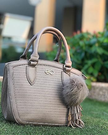 Elegantly embellished tassel and pom-pom brings that cutting edge beauty to this handbag #E2oFashion