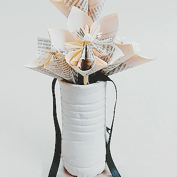 Vase made from recycled materials offers a sleek home accessory to style your tabletops and Shelving. set of 5 flowers are arranged and wrapped into a full bouquet  With ribbons of black against a white finish to add a touch of glamour to your decor.  #handmade #handmadeitems #paper #ribbon #madetoorder #fav #flower #paperflowers #greenandblue2017 #greenandblue.in #love #salman #art #delhigirl