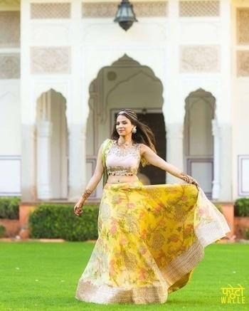 That's how you flash the floral lehenga!!!  Shop stylish Lehengas for Weddings from WedLista.com- India's Premier 'Fashion for Weddings' Online Destination!  (c) fotowalle  #WedLista #FashionForWeddings