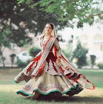 All her joy is wrapped up in the twirl of her magnificient bridal lehenga.  Buy your bridal lehenga from WedLista.com to have a joyous wedding.  Captured by: @studiokellyphotography  #WedLista #FashionForWeddings