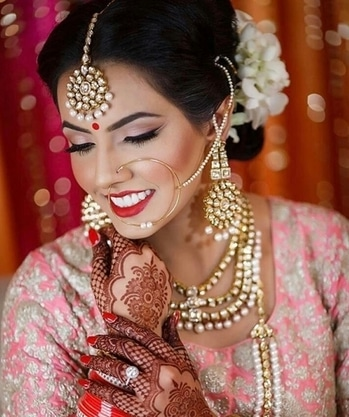This gorgeous bride shines like a moon with her shimmering jewels & perfect makeup.  Shop for bridal jewellery & makeup from WedLista.com to be like this beauty.  Pic credits: @elegantlooks  #WedLista #FashionForWeddings