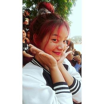 #cute #cutepose #cutiepie #red #burgundy #hair #roposo #messy #bunhairstyle
