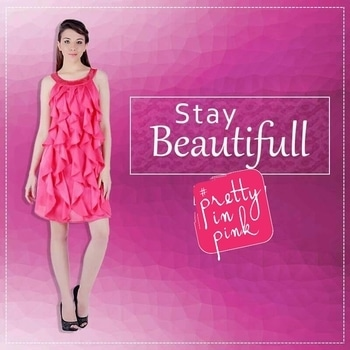 Woman pink dress with frills at front which will make your look more elegant and beautiful. Designed using satin fabric with texo lining. featuring pink sequinned neck, concealed zipper at back. #women #pink #dress #dress-up #prettyinpink
