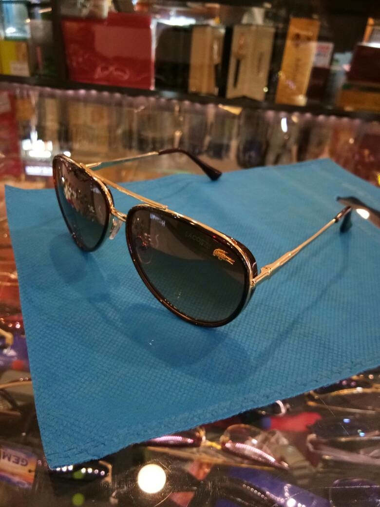 Gorgeous Lacoste Shades PRICE RS 950/ONLY