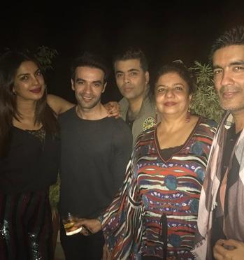 Priyanka Chopra is seen posing with her guests Karan Johar, Manish Malhotra, Puneet Malhotra and her mom Madhu Chopra.