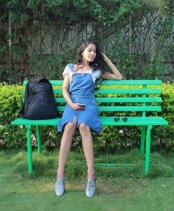 Mornings at this pretty bench! #streetstyle #pinaforedress #overalls #dungareelove #denimdress #denimlove #fashionfables #soroposo #ropolove #soropogood #ropogirl #blogger #casualwear #casualdenim #fashionblogger #stylist #stylistdiaries